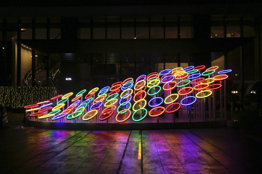 night view, wheels of life, alva hotel, red dot award winner, art installation
