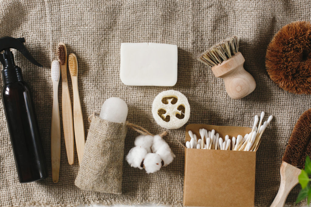 eco natural bamboo toothbrush, crystal deodorant,luffa, coconut soap,brushes,ear sticks, cotton. zero waste flat lay. home essentials, plastic free items. sustainable lifestyle concept
