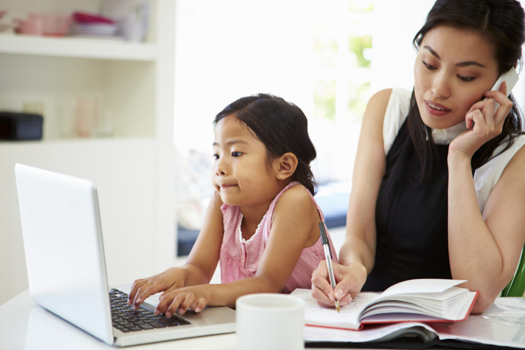 Busy Mother Working From Home With Daughter, work from home